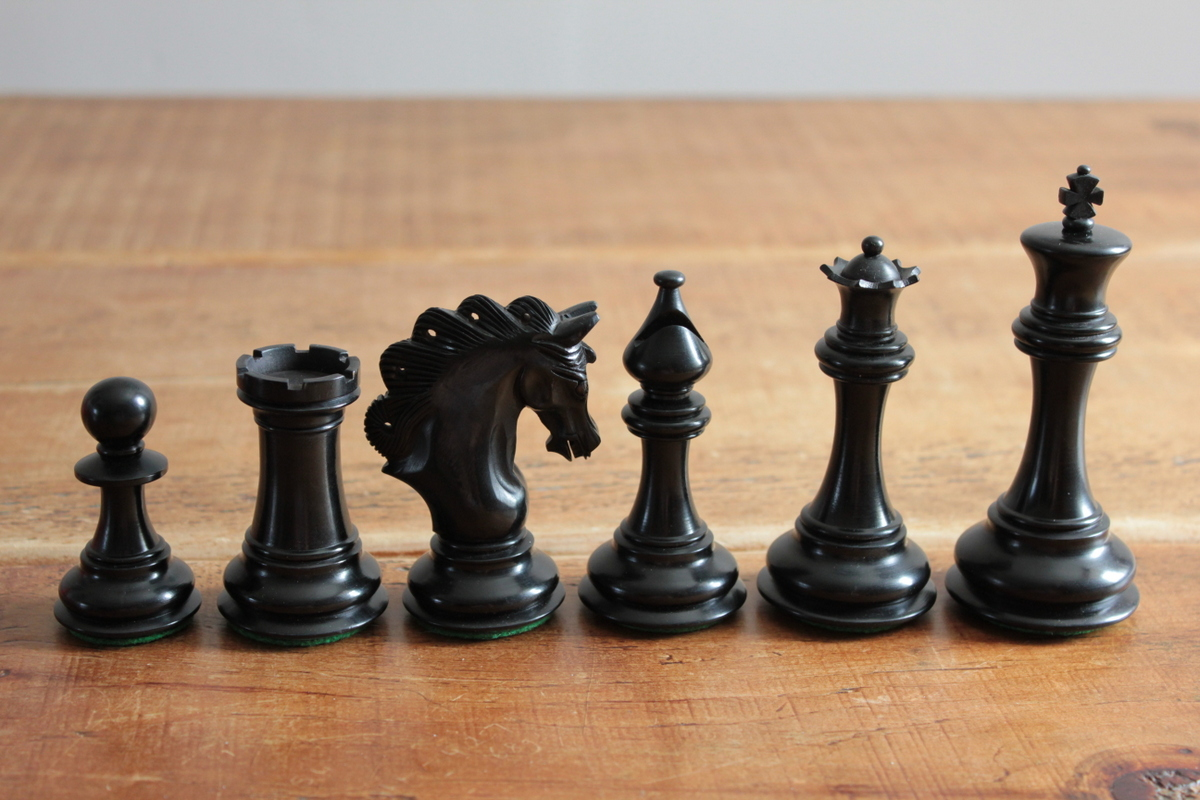 The Mayfield Triple Weighted Chess Pieces in Red and Black